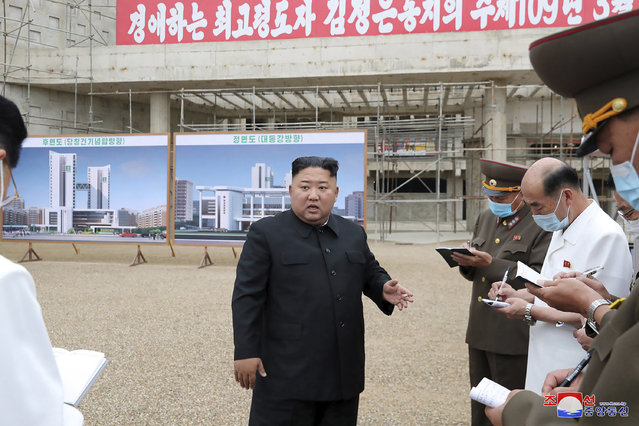 """In this undated photo provided on Monday, July 20, 2020 by the North Korean government, North Korean leader Kim Jong Un, center, visits a construction site of a hospital in Pyongyang, North Korea. Independent journalists were not given access to cover the event depicted in this image distributed by the North Korean government. The content of this image is as provided and cannot be independently verified. Korean language watermark on image as provided by source reads: """"KCNA"""" which is the abbreviation for Korean Central News Agency. (Photo by Korean Central News Agency/Korea News Service via AP Photo)"""