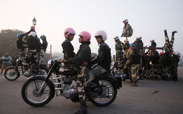 """Border Security Force (BSF) """"Daredevils"""" women motorcycle riders perform during a rehearsal for the Republic Day parade on a cold winter morning in New Delhi, January 10, 2018. (Photo by Adnan Abidi/Reuters)"""