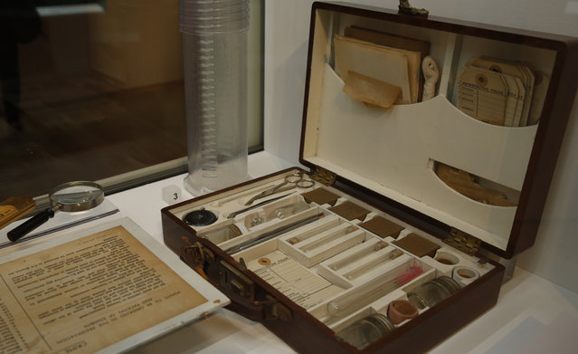 A Metropolitan police 'Murder Bag' from the late 1940's to 50's, containing all the police officers forensic needs, is displayed as part of the Crime Museum Uncovered exhibition at the Museum of London in the City of London, Wednesday, October 7, 2015. (Photo by Alastair Grant/AP Photo)
