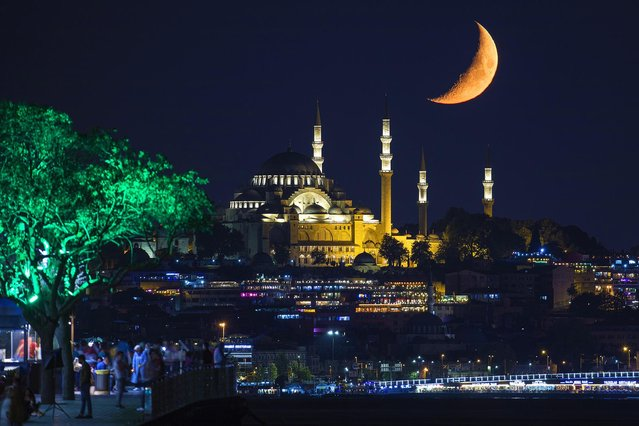 Crescent moon is seen shining in the sky over Suleymaniye Mosque in Istanbul, Turkey on August 23, 2020. (Photo by Isa Terli/Anadolu Agency via Getty Images)