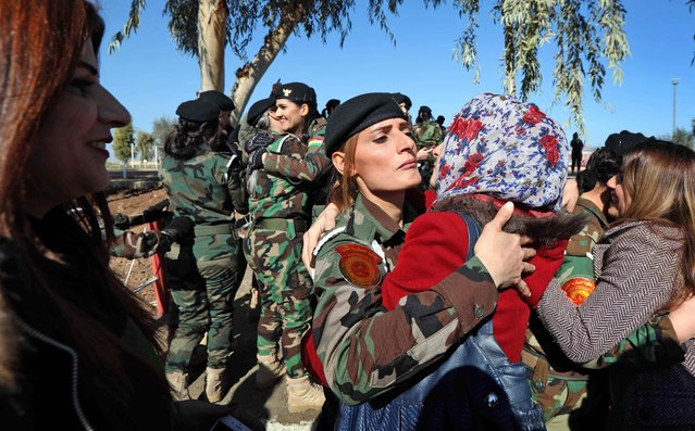 Iraqi Kurds congratulate Peshmerga fighters during a graduation ceremony at the Zakho military academy in the Iraqi Kurdish town of Zakho, some 500 kilometres north of Baghdad, on January 30, 2018. (Photo by Safin Hamed/AFP Photo)