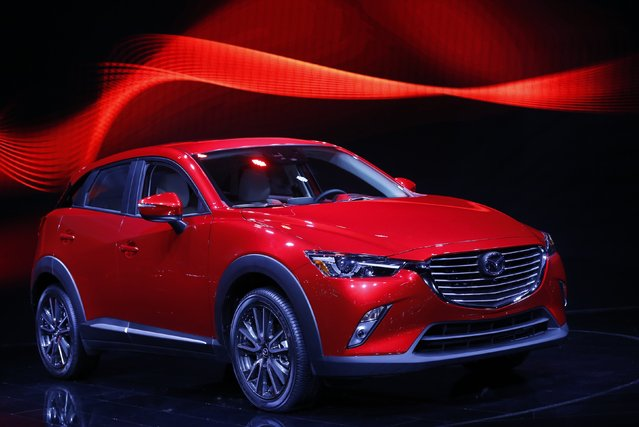 The Mazda CX-3 Compact Crossover Utility vehicle is displayed during the model's world debut at the Los Angeles Auto Show in Los Angeles, California November 19, 2014. (Photo by Mario Anzuoni/Reuters)
