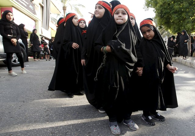 Muslim Shi'ite girls take part in a march organised by Hezbollah during a re-enactment of the battle of Kerbala during a mourning process, ahead of the day of Ashura, in Saksakieh village, southern Lebanon, October 18, 2015. (Photo by Ali Hashisho/Reuters)