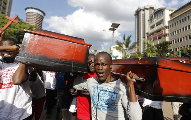 Protesters carry coffins during the #OccupyHarambeeAve protest in Kenya's capital Nairobi November 25, 2014. (Photo by Thomas Mukoya/Reuters)
