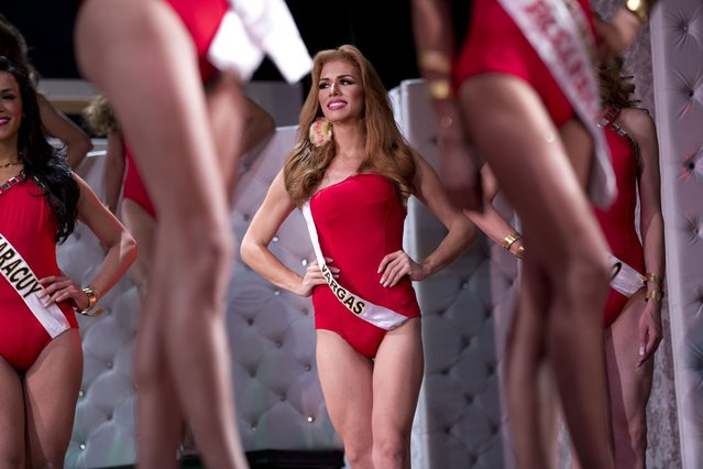 "In this October 18, 2015 photo, contestant Carlos Angevil, Miss Gay Vargas, competes in the swimsuit category of the ninth annual Miss Gay Venezuela beauty pageant in Caracas, Venezuela. Miss Gay Venezuela requires contestants be younger than 37 and be at least 1.7 meters (5' 6"" feet) tall. (Photo by Ariana Cubillos/AP Photo)"