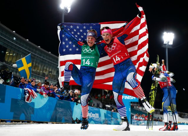 United States' Jessica Diggins, left, and Kikkan Randall celebrate after winning the gold medal in the women's team sprint freestyle cross-country skiing final at the 2018 Winter Olympics in Pyeongchang, South Korea, Wednesday, February 21, 2018. (Photo by Matthias Schrader/AP Photo)
