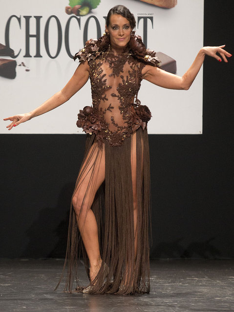 French TV Host Karine Lima presents a chocolate studded dress during a show as part of the chocolate fair in Paris, Tuesday, October 27, 2015. (Photo by Jacques Brinon/AP Photo)