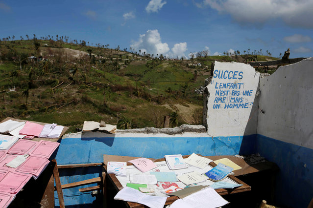 Papers dry at the direction office of a school destroyed by Hurricane Matthew in the outskirts of Port Salut, Haiti, October 7, 2016. (Photo by Andres Martinez Casares/Reuters)