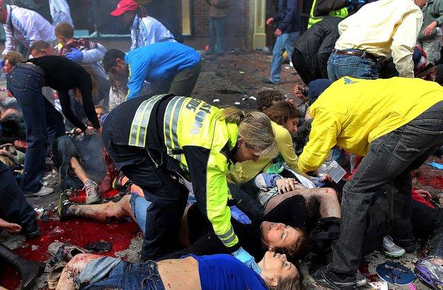 The scene moments after the first explosion near the finish line. (Photo by John Tlumacki/The Boston Globe)