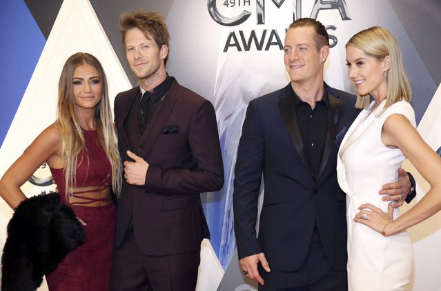 Brian Kelley (2nd L) with his wife, Brittney Marie Cole, and Tyler Hubbard with his wife, Hayley Stomme, arrive at the 49th Annual Country Music Association Awards in Nashville, Tennessee November 4, 2015. (Photo by Jamie Gilliam/Reuters)