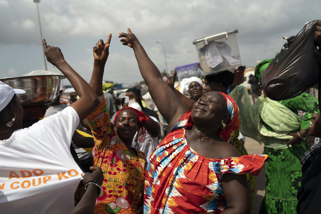 A woman celebrates the victory of Ivory Coast's President Alassane Ouattara after elections in Abidjan, Ivory Coast, Tuesday, November 3, 2020. (Photo by Leo Correa/AP Photo)