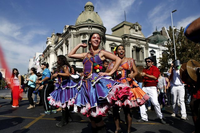 "Participants in costume dance during a parade commemorating Earth Day in downtown Santiago, April 22, 2013. Students and environmental interest organisations participated in the parade, themed ""March for the Protection of Water"". (Photo by Ivan Alvarado/Reuters)"