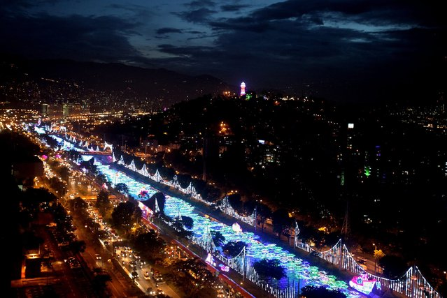 "General view of the Christmas illuminations in Medellin, Colombia, 09 December 2014. The Christmas ""Lighting"" has become notorious in Medellin: over 14.5 million bulbs, 300 km of lit cables, 21 parks, a path of light stretching for four km long in down town and a cultural program throughout December makes Christmas one of the best times to visit Medellin. (Photo by Luis Eduardo Noriega/EPA)"