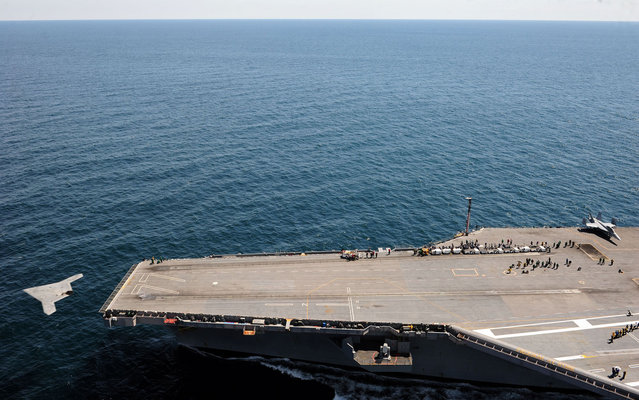 The X-47B makes its catapult launch from USS George H.W. Bush, May 14, 2013. (Photo by MC3 Brian Read Castillo/Marinha dos EUA/AFP Photo)
