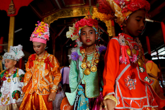 Boys stay inside a temple during an annual Poy Sang Long procession, part of the traditional rite of passage for boys to be initiated as Buddhist novices, in Mae Hong Son, Thailand, April 3, 2018. (Photo by Jorge Silva/Reuters)