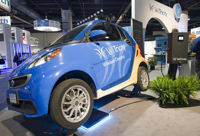 A WiTricity wireless car charger is shown under an electric car during the 2015 International Consumer Electronics Show (CES) in Las Vegas, Nevada January 6, 2015. (Photo by Steve Marcus/Reuters)