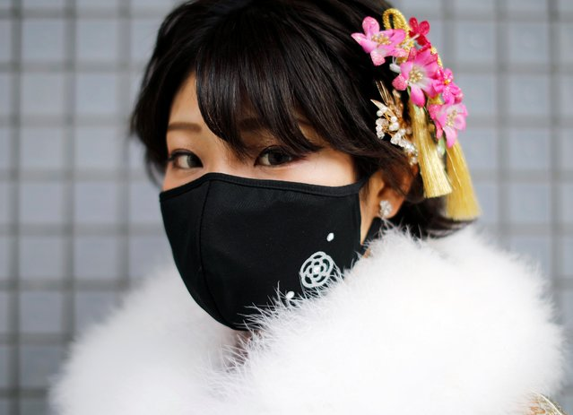 A Kimono-clad woman wearing a fashionable face mask poses for a photograph at Coming of Age Day celebration ceremony at Yokohama Arena after the government declared the second state of emergency for the capital and some prefectures, amid the coronavirus disease (COVID-19) outbreak, in Yokohama, south of Tokyo, Japan on January 11, 2021. (Photo by Issei Kato/Reuters)
