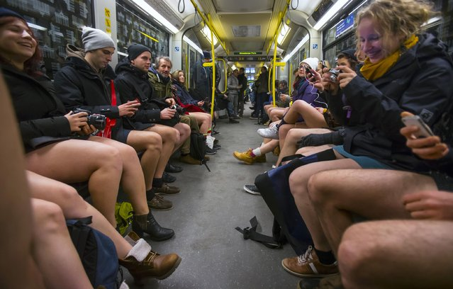 People take part in the No Pants Subway Ride in Berlin January 11, 2015. (Photo by Hannibal Hanschke/Reuters)