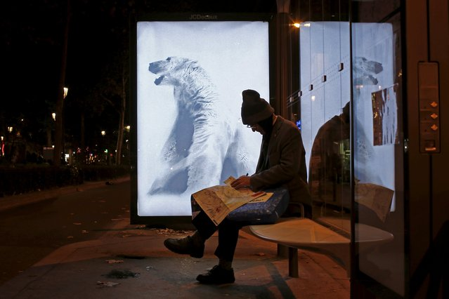"A poster by street artist Aaron Li-Hill as part of the ""Brandalism"" project is displayed at a bus stop in Paris, France, November 28, 2015, ahead of the United Nations COP21 Climate Change conference in Paris. (Photo by Benoit Tessier/Reuters)"
