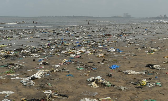 Plastic waste is pictured on Juhu beach in Mumbai, India on June 2, 2018. (Photo by Punit Paranjpe/AFP Photo)