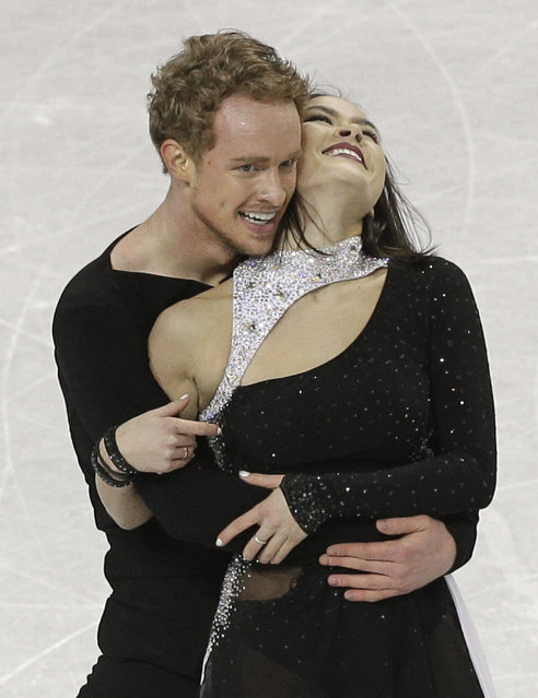 Madison Chock and Evan Bates react after their free dance program at the U.S. Figure Skating Championships in Greensboro, N.C., Saturday, January 24, 2015. (Photo by Chuck Burton/AP Photo)