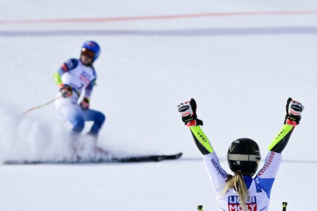 Lara Gut-Behrami of Switzerland, right, celebrates his first place, front of Mikaela Shiffrin of the United States, left, in the finish area during the second run of the women's Giant Slalom race at the 2021 FIS Alpine Skiing World Championships in Cortina d'Ampezzo, Italy, Thursday, February 18, 2021. (Photo by Jean-Christophe Bott/Keystone)