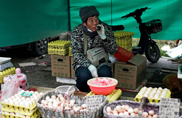 Vendors are selling eggs in an open market on December 2, 2020 in Wuhan, Hubei province, China. As there have been no recorded cases of community transmissions since May, life for residents is gradually returning to normal. (Photo by Getty Images)