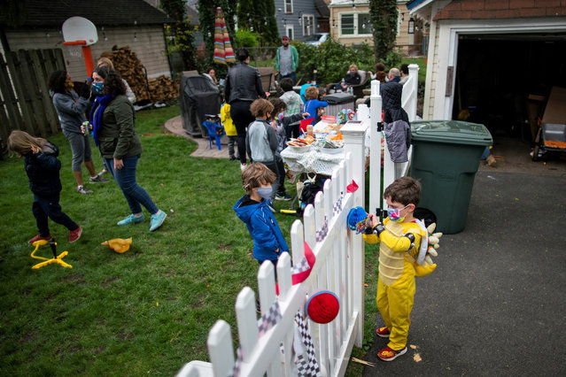 Reuben Goodman adjusts decorations as he plays with friends in the backyard during his 6th birthday party in person, after all family members have been vaccinated against the coronavirus disease (COVID-19), in South Orange, New Jersey U.S., April 17, 2021. (Photo by Eduardo Munoz/Reuters)