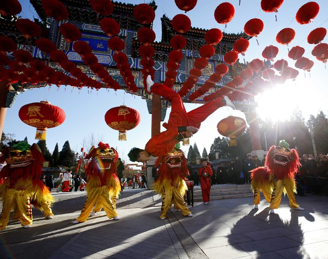 Traditional dancers perform lion dance during the opening of the temple fair for the Chinese New Year celebrations at Ditan Park, also known as the Temple of Earth, in Beijing February 18, 2015. (Photo by Kim Kyung-Hoon/Reuters)