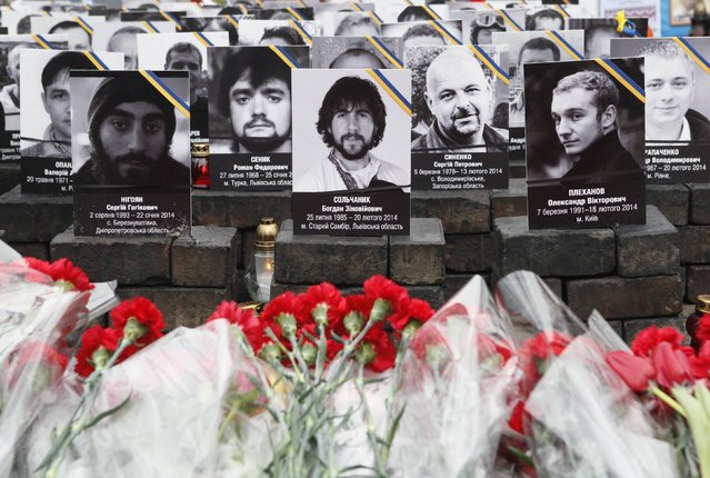Photos of those killed in anti-government protests in 2014 are on display during a commemorating ceremony near Independence Square in Kiev, February 20, 2015. Ukraine will mark the first anniversary of the ousting of the pro-Moscow President Viktor Yanukovich next weekend, honouring the memory of the 100 or so civilians killed in protests against him. (Photo by Valentyn Ogirenko/Reuters)