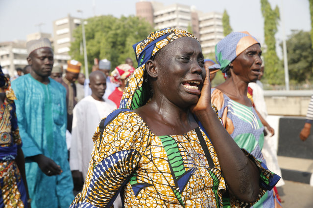 The mother of a missing Chibok girl reacts during a march, with other women calling for their daughters to be brought back home, to the presidential villa in Abuja, Nigeria January 14, 2016. Picture taken January 14, 2016. (Photo by Akintunde Akinleye/Reuters)
