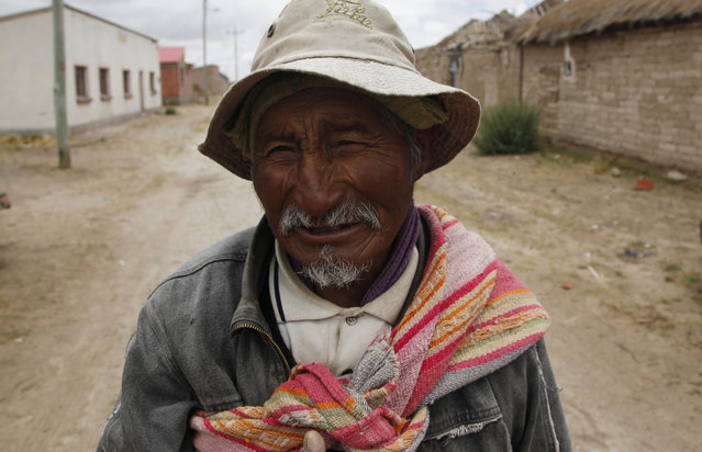 """In this January 12, 2016 photo, fisherman Felix Rojas, 78, speak with the Associated Press, in Untavi, near lake Poopo, Bolivia. """"With a group of peasants we started fishing in Lake Poopo. With the winnings from fishing I have payed for my children's education and have been able to feed them well. Now we are very sad that the lake has dried up. I do not know what is going to happen to our children and grandchildren? How are they going to survive? But we have to come up with imaginative solutions"""". (Photo by Juan Karita/AP Photo)"""