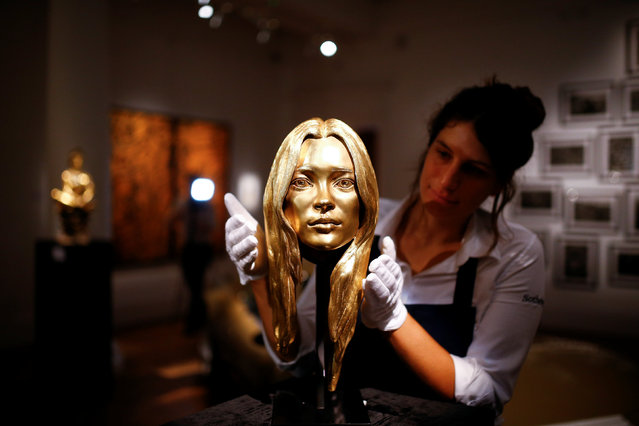 A bust of Kate Moss in 18-carat gold is displayed at Sotheby's auction house in London, Britain, October 12, 2018. (Photo by Henry Nicholls/Reuters)