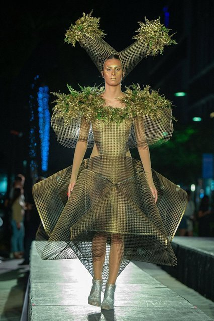 """A model wears a creation by Cuban designer Celia Ledon, during a fashion art show held at Doral City Place in Doral, Florida, USA, 03 June 2021. A parade of """"wearable installations"""" created by Cuban Celia Ledon with unusual materials officially dismissed The Legacy exhibition, which for six months brought together a score of monumental works by Spanish plastic artist Manolo Valdes in public spaces in Doral. (Photo by Agencia EFE/Rex Features/Shutterstock)"""