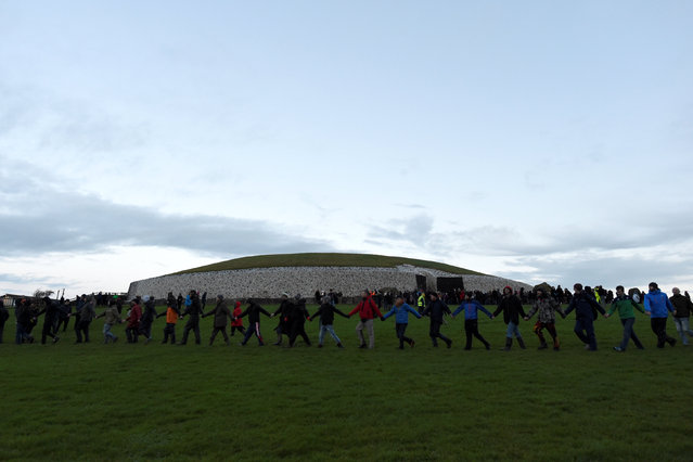 Revellers arrive to celebrate winter solstice at the 5000 year old stone age tomb of Newgrange in the Boyne Valley at sunrise in Newgrange, Ireland, December 21, 2016. (Photo by Clodagh Kilcoyne/Reuters)