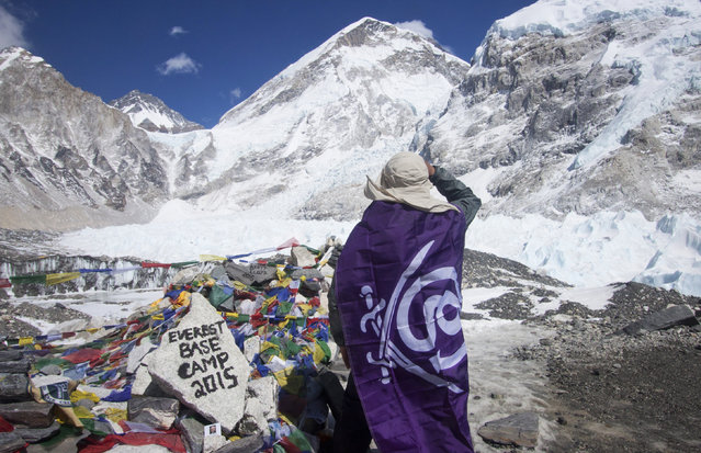 In this Saturday, March 21, 2015 photo, a trekker rests after reaching Everest Base camp, Nepal. Nepal has cleared more than 300 mountaineers to climb Mount Everest after they had to abandon last year's efforts when an ice avalanche killed 16 guides in the mountain's deadliest disaster, an official said on March 20. The three-month climbing season for Everest, the world's tallest mountain, begins in March. (Photo by Tashi Sherpa/AP Photo)