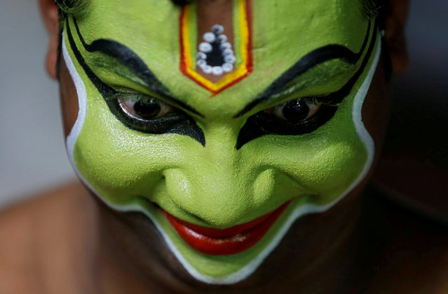 "An artist gets ready backstage to perform an Indian art form of dance called ""Ottamthullal"" at the annual eight-day long Vrischikolsavam festival, which features a colourful procession of decorated elephants along with drum and trumpets concerts, at Sree Poornathrayeesa temple in Kochi, India, December 7, 2018. (Photo by Sivaram V/Reuters)"