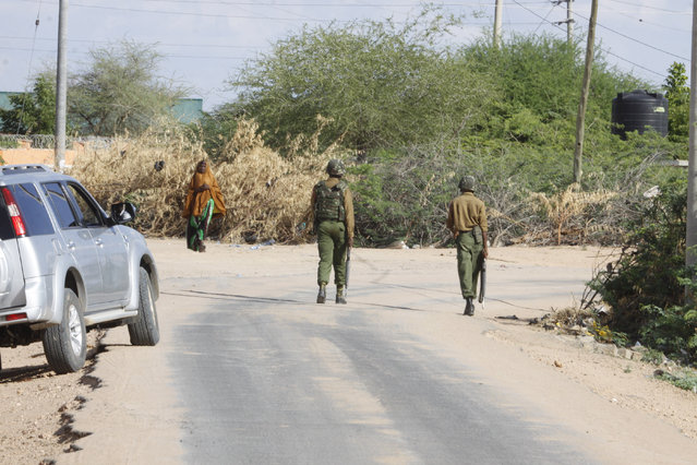 A member of Kenya Defence Forces secures the area of the Garissa University college, in Garissa, Kenya, Thursday, April 2, 2015. (Photo by Khalil Senosi/AP Photo)