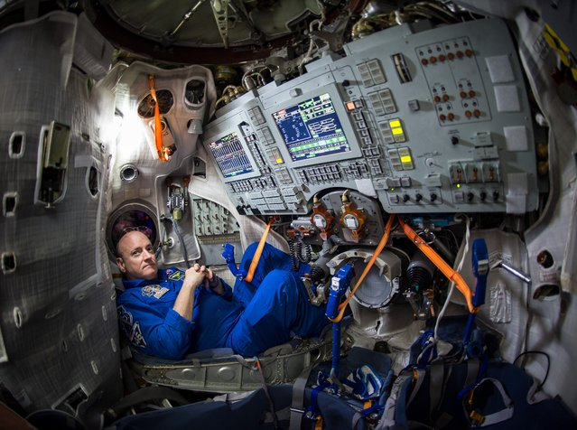 NASA Astronaut Scott Kelly is seen inside a Soyuz simulator at the Gagarin Cosmonaut Training Center (GCTC), Wednesday, March 4, 2015 in Star City, Russia. Kelly, along with Expedition 43 Russian cosmonaut Mikhail Kornienko of the Russian Federal Space Agency (Roscosmos). (Photo by Bill Ingalls/NASA)