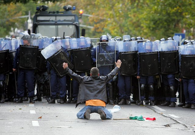 A protestor faces a line of riot police during an anti-government protest in Budapest, in this October 23, 2006 file photo. (Photo by Laszlo Balogh/Reuters)