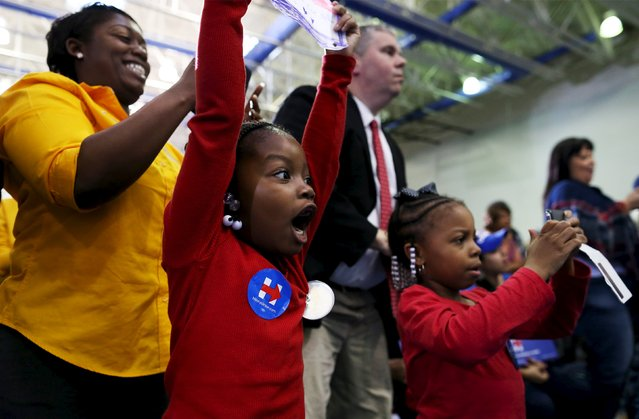 Six-year-old Kayla Johnson (C) her mother Andrea (L) and friend London Walters (R) react as U.S. Democratic presidential candidate Hillary Clinton enters the Garrick-Boykin Human Development Center at Morris College in Sumter, South Carolina, February 24, 2016. (Photo by Randall Hill/Reuters)