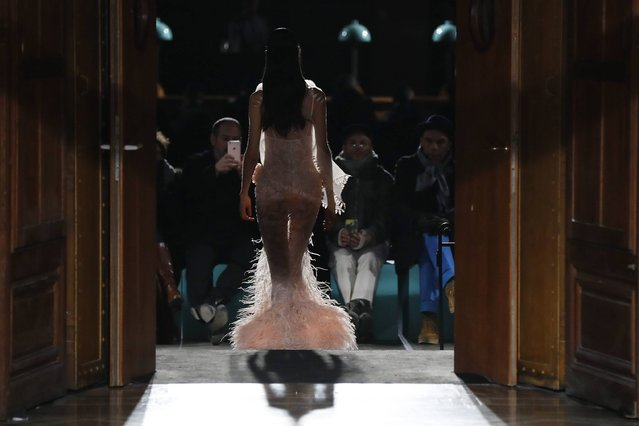 A model presents a creation by Givenchy during men's Fashion Week for the Fall/Winter 2017/2018 collection in Paris on January 20, 2017. (Photo by Patrick Kovarik/AFP Photo)