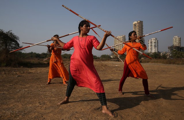 Women practice Shivkalin Yudha Kala, a Maharashtrian martial art on the eve of International Women's Day, at a ground on the outskirts of Mumbai, India March 7, 2019. (Photo by Francis Mascarenhas/Reuters)