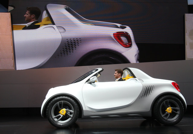 """The """"smart for-us"""" concept car is displayed during the first press preview day for the North American International Auto Show in Detroit, January 9, 2012. (Photo by Rebecca Cook/Reuters)"""