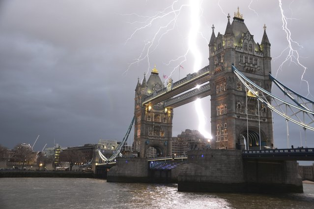 A stunning and once in a lifetime image of a lightening bolt striking over Tower Bridge in London. (Photo by Daoud Fakhri/LNP)