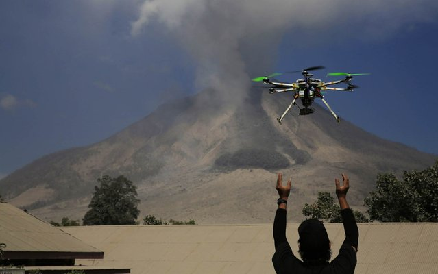 An official of the Center for Research and Technology Volcanoes Development (BPPTK) releases a drone quadcopter to monitor activity from the Mount Sinabung volcano at Sibintun village in Karo district, North Sumatra province on February 4. Indonesia's Mount Sinabung volcano erupted and killed at least 11 people on the western island of Sumatra on Saturday, the first time it is known to have claimed any lives, a senior government official said. (Photo by Reuters/Beawiharta)
