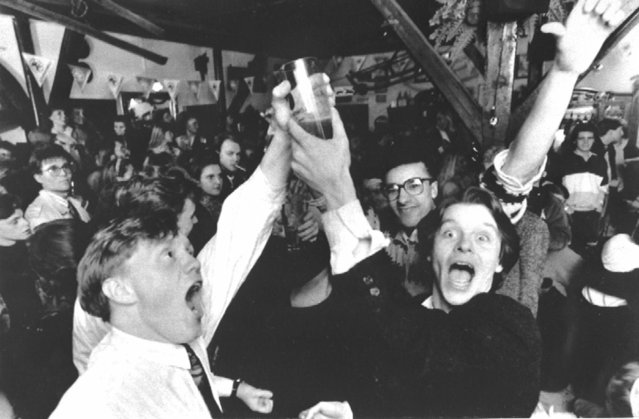 In this Wednesday March 2, 1989 file photo, Icelanders celebrate in a Reykjavik bar, as the first legal beer since 1915 went on sale in the Icelandic capital, which was banned following a referendum. Icelanders are celebrating the end, three decades ago, of a sobering dry spell in their country's history. On Friday, March 1, 2019 the country toasts the anniversary of the lifting of a decades-long ban on beer with – what else? – a nationwide Beer Day. (Photo by AP Photo/Rax)