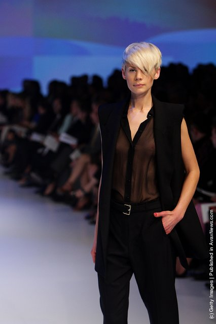 A model showcases designs by Scanlan & Theodore on the catwalk at the David Jones Spring/Summer 2011