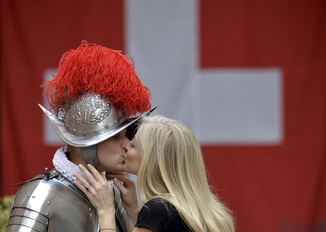 Dominic Bergamin, left, a new Vatican Swiss Guard, is is kissed by his wife Joanne, prior to a swearing-in ceremony, at the Vatican, Wednesday, May 6, 2015. (Photo by Ettore Ferrari/AP Photo/Pool Photo)