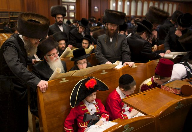 Ultra-Orthodox Jewish boys from the Belz Hasidic dynasty dressed in Purim costumes take part in the reading from the Book of Esther ceremony performed on the Jewish holiday of Purim, in Jerusalem March 24, 2016. (Photo by Ronen Zvulun/Reuters)